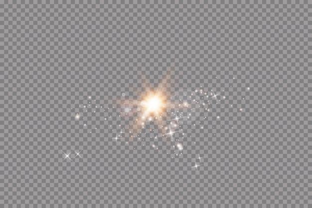 Conjunto de efeitos de luzes brilhantes douradas sobre fundo transparente. sol flash com raios e holofotes. efeito de luz de brilho. star explodiu com brilhos.