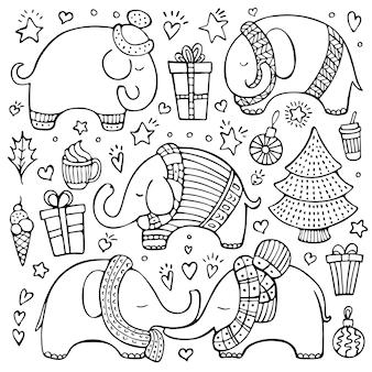 Conjunto de elefantes bonitos desenhados à mão e elementos de natal isolados no fundo branco