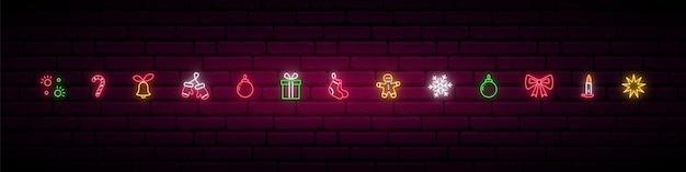 Conjunto de elementos decorativos de natal em estilo neon.