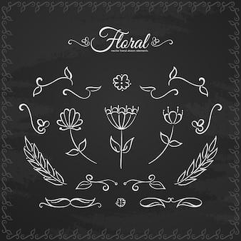 Conjunto de elementos florais desenhados à mão na lousa