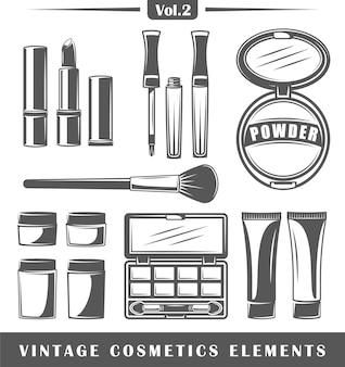 Conjunto de elementos vintage cosméticos isolado no fundo branco.