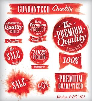 Conjunto de emblemas de qualidade premium de aguarela vermelho