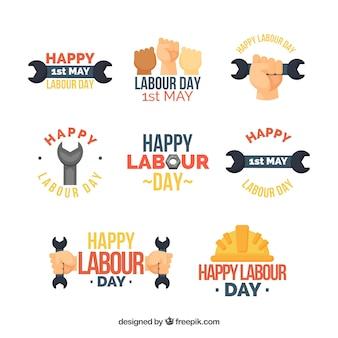 Conjunto de emblemas do dia do trabalho em estilo simples