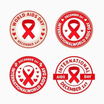 Conjunto de emblemas do dia mundial da aids com fitas vermelhas