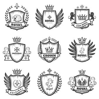 Conjunto de emblemas heráldicos monocromáticos vintage