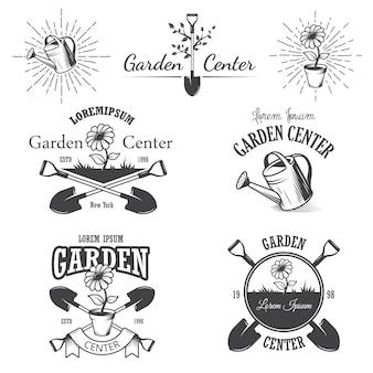 Conjunto de emblemas vintage centro de jardim, etiquetas, emblemas, logotipos e elementos desenhados. estilo monocromático