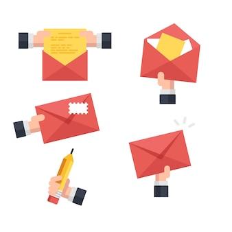 Conjunto de envelope postal, mão segure a carta aberta, mão segure lápis, enviando uma carta