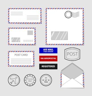 Conjunto de envelopes de correio aéreo, cartão postal e crachás. publicar selo na carta