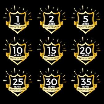 Conjunto de escudos de aniversário de ouro