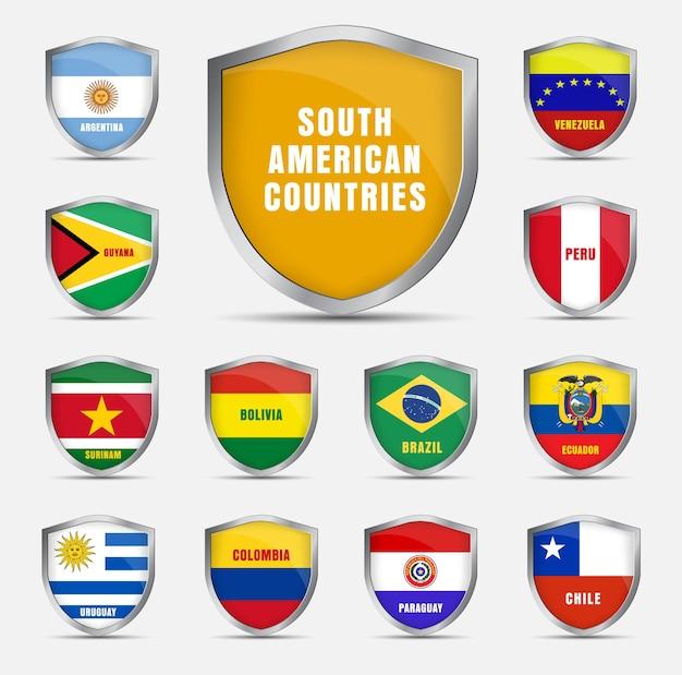 Conjunto de escudos metálicos com bandeiras e o nome dos países sul-americanos.