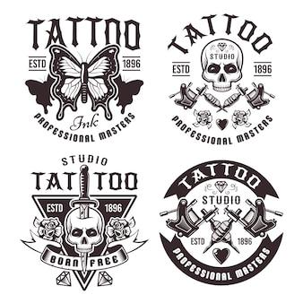 Conjunto de estúdio de tatuagem com quatro emblemas vintage