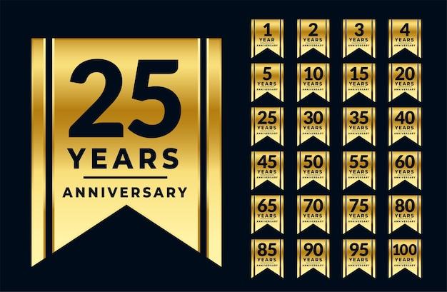 Conjunto de etiquetas ou emblemas dourados de aniversário estilo fita