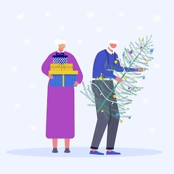 Conjunto de família de natal. pessoas adultas com presente e árvore de natal. presente sob a árvore e flocos de neve