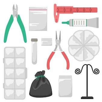 Conjunto de ferramentas e recipientes de armazenamento para joias feitas à mão.