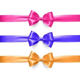 Conjunto de fitas e laços realistas em rosa, roxo e laranja