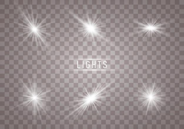 Conjunto de flashes brancos, luzes, estrelas e brilhos em um fundo transparente.