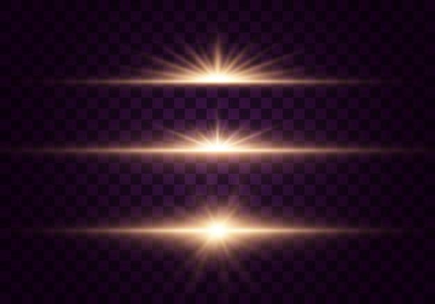 Conjunto de flashes, luzes e brilhos em um fundo transparente. ouro brilhante pisca e brilha. abstratas luzes douradas isoladas. raios de luz brilhantes.