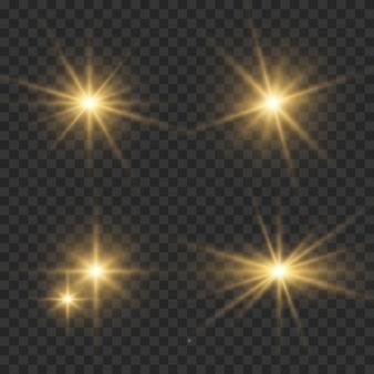 Conjunto de flashes, luzes e brilhos em um fundo transparente. Vetor Premium