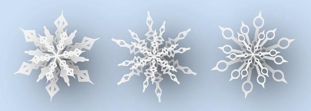 Conjunto de flocos de neve de corte de papel.