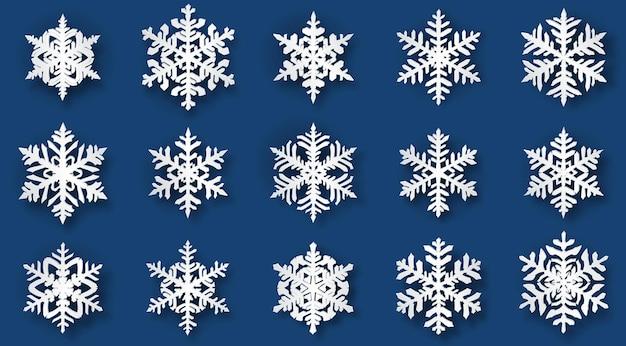 Conjunto de flocos de neve de natal de belo volume complexo com sombras suaves, branco sobre fundo azul