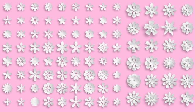 Conjunto de flores de papel volumoso branco com sombras suaves em fundo rosa