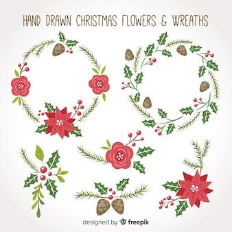 Conjunto de flores e grinaldas de natal de mão desenhada