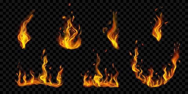Conjunto de fogueiras a arder translúcidas e chamas de fogo com faíscas em fundo transparente. para uso em ilustrações escuras. transparência apenas em formato vetorial