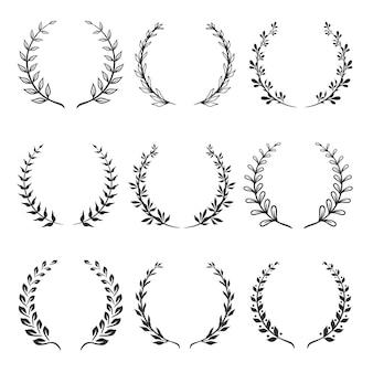 Conjunto de folhas de louro circulares e coroas de trigo