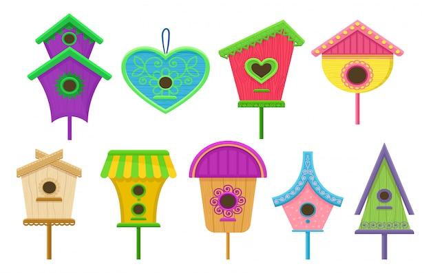 Conjunto de gaiolas coloridas. caixas de nidificação para pássaros. elementos decorativos planos