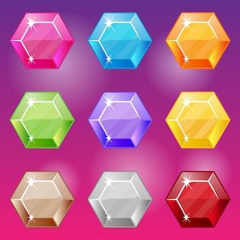 Conjunto de gemas coloridas diferentes de forma hexágono.