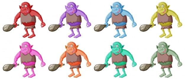 Conjunto de goblin colorido ou troll segurando a ferramenta de caça com cara de smail em personagem de desenho animado isolada