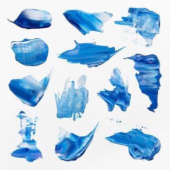 Conjunto de gráficos de arte criativa, borrão de tinta azul texturizado, pincelada de vetor