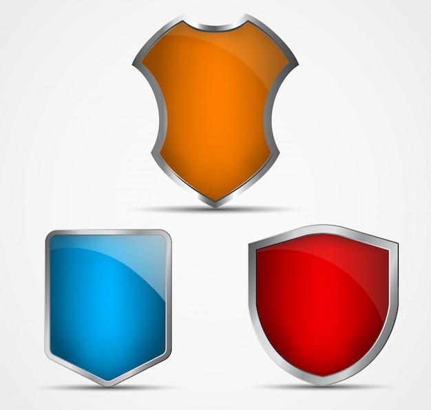 Conjunto de ícones de diferentes cores e formas de escudos
