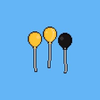 Conjunto de ícones do pixel art balão dourado.