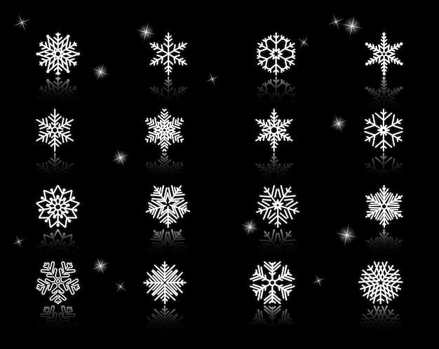 Conjunto de ícones variados de flocos de neve brancos sobre fundo preto com faíscas.