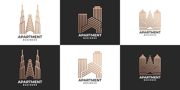 Conjunto de ideia de logotipo de edifício dourado elegante