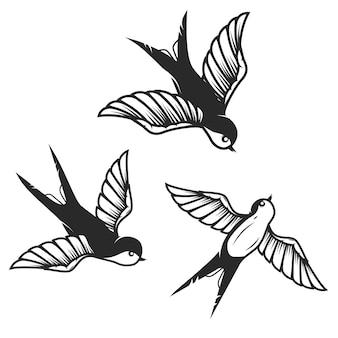 Conjunto de ilustrações de andorinha desenhadas à mão em fundo branco. elementos para cartaz, cartão. imagem