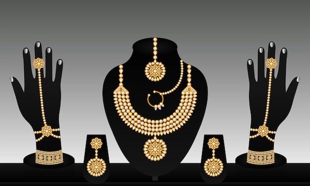 Conjunto de joias de ouro de vetor tradicional indiana premium vector