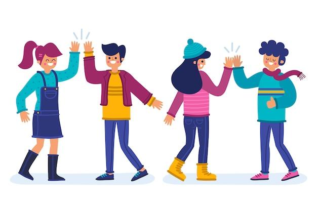 Conjunto de jovens acenando a mão