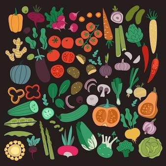 Conjunto de legumes. cor cenoura cebola pepino tomate batata berinjela. vegetal de comida orgânica vegetariana refeição saudável na coleção de fundo escuro