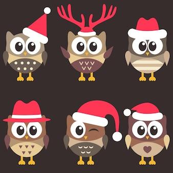 Conjunto de lindas corujas marrons com chapéus de natal