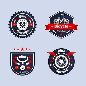 Conjunto de logotipo de bicicleta em design plano