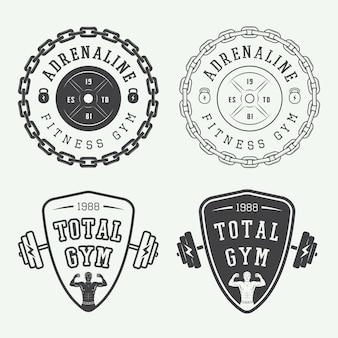 Conjunto de logotipos de ginásio, etiquetas e emblemas em estilo vintage