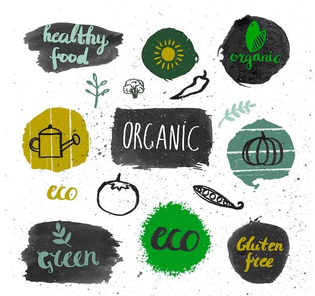 Conjunto de logotipos de tinta. emblemas, folhas de etiquetas, fitas, louro de elementos de plantas. modelo de design natural orgânico, bio ecologia. pintura de desenho à mão. vetor vintage, preto e branco