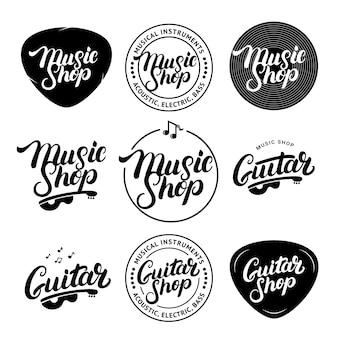 Conjunto de loja de música e loja de guitarra mão escrita letras logotipos, etiquetas, emblemas, distintivos.