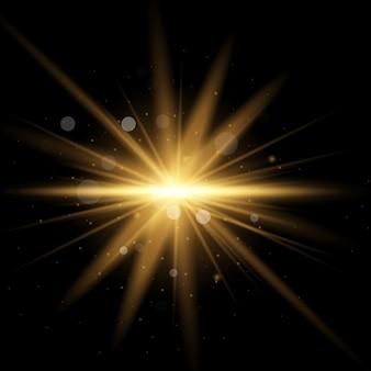 Conjunto de luz amarela brilhante explode em um fundo preto. partículas de poeira mágica cintilante. estrela estourou com brilhos. glitter dourado estrela brilhante. sol brilhante e transparente, flash brilhante.