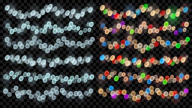 Conjunto de luzes de fada desfocadas em tons de azul claro e multicoloridas com efeitos bokeh