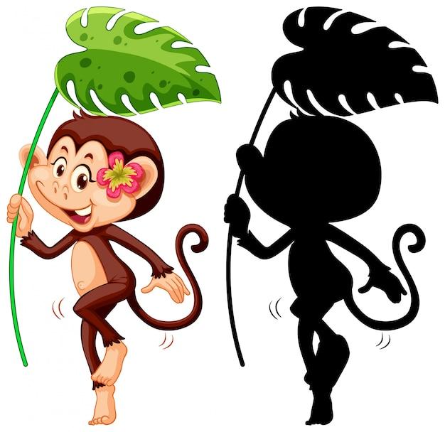 Conjunto de macaco segurando folha e sua silhueta
