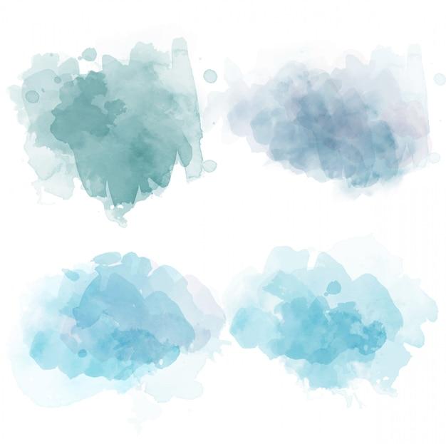 Conjunto de manchas de aquarela isoladas em branco