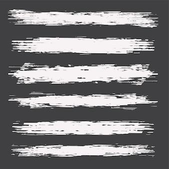 Conjunto de manchas de bordas de traços de tinta grunge